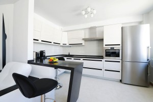 A classic, mainly white kitchen with black details