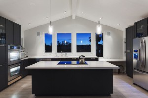 A modern black and white kitchen in a luxury house