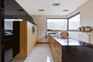 Beautiful kitchen in modern style with black and wooden cabinetry