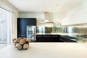 Beautiful, modern black and white kitchen with stainless steel