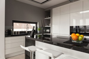 Modern and clean kitchen in black, white and grey tones.