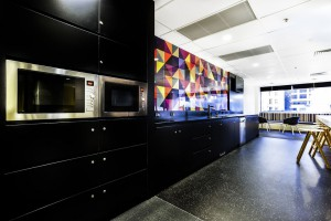 Black and white kitchen with beautiful colorful splashes
