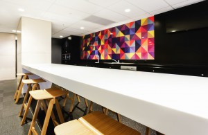 Black and white kitchen with colorful wall tiles.