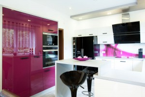 Black and white kitchen with purple color splashes