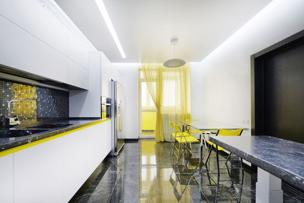 black and white kitchen with yellow splashes