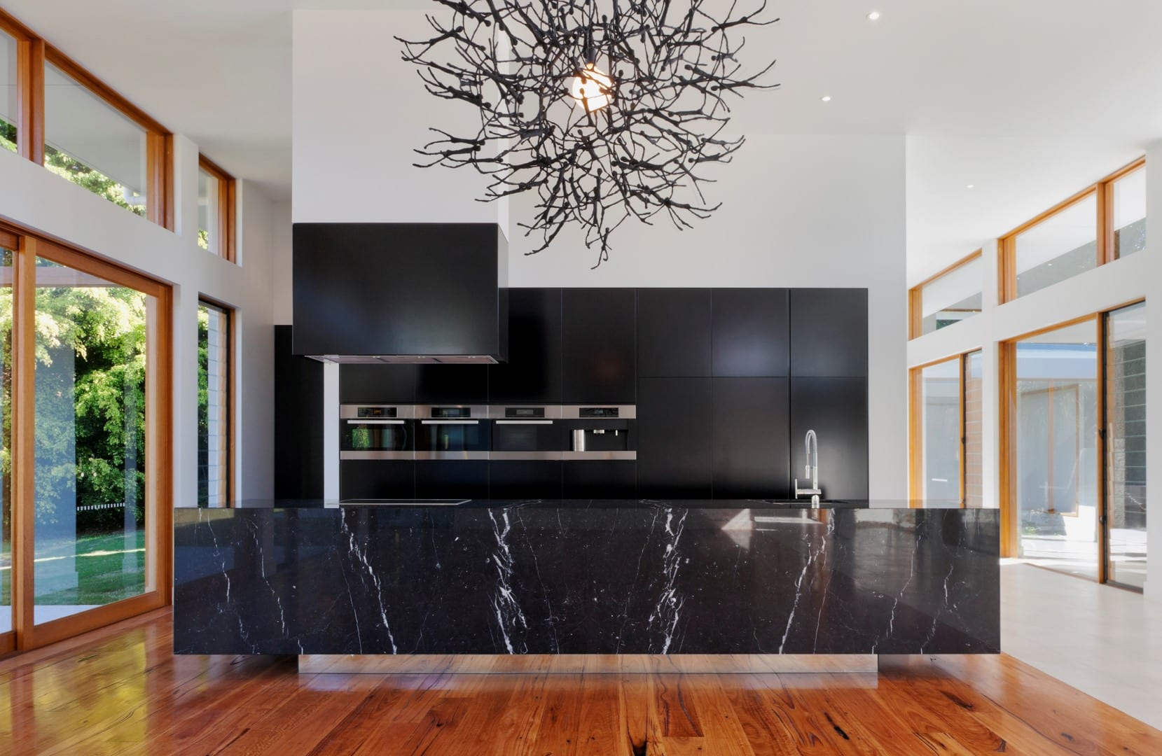 Stunning, black marble kitchen and a georgeous focal point.