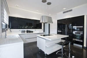 A modern Black & white kitchen with high‐gloss finishes.