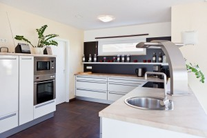 Classic white kitchen interior with contrasting black walls