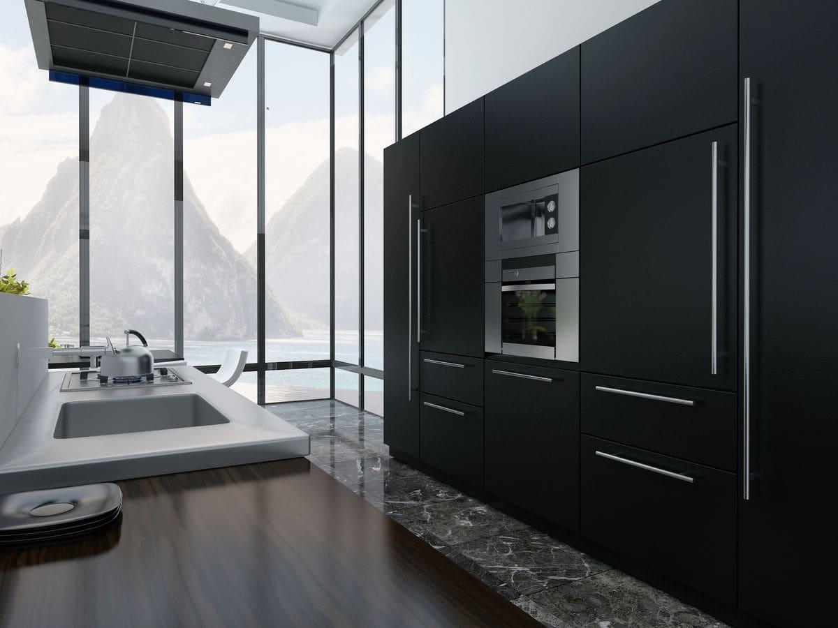Impressive black open plan kitchen.