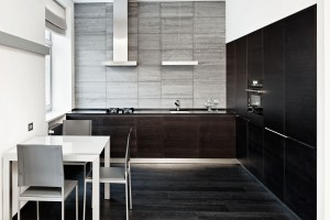 Minimalism style black kitchen with grey and white accents.