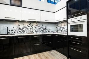 Modern black and white kitchen interior with floral oramentation.