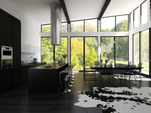 Modern design, black open plan kitchen in a luxury home.