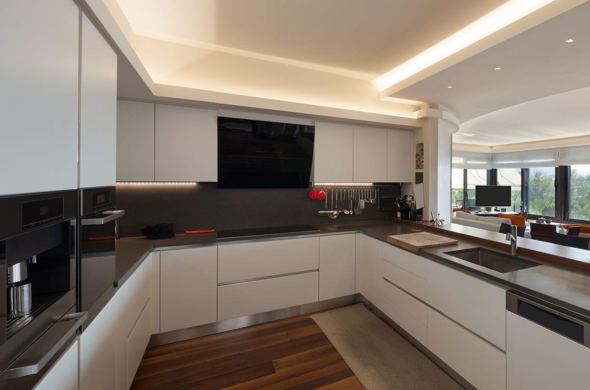 Black & white kitchen design with granite countertops