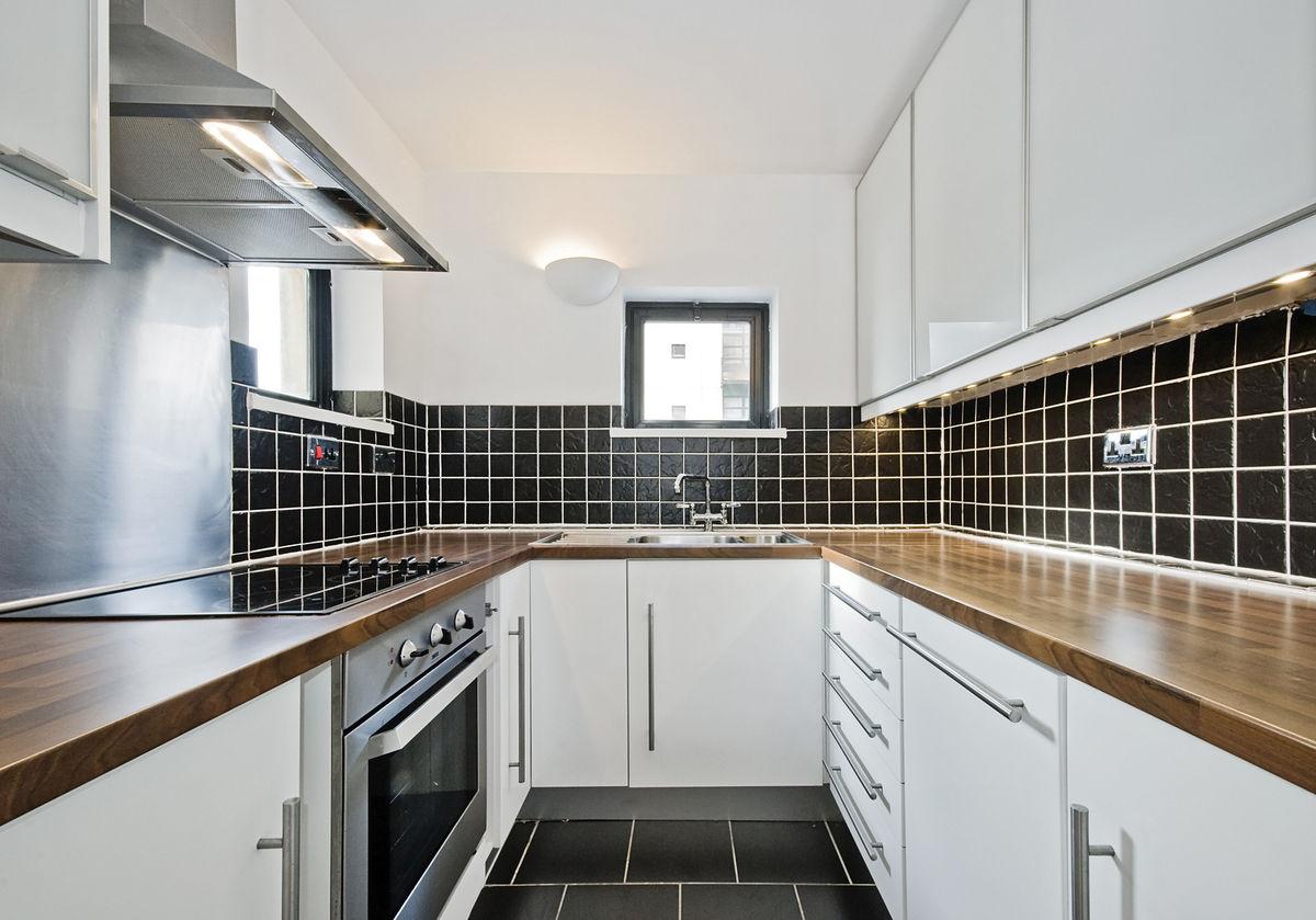 Modern kitchen with black ceramic tiles