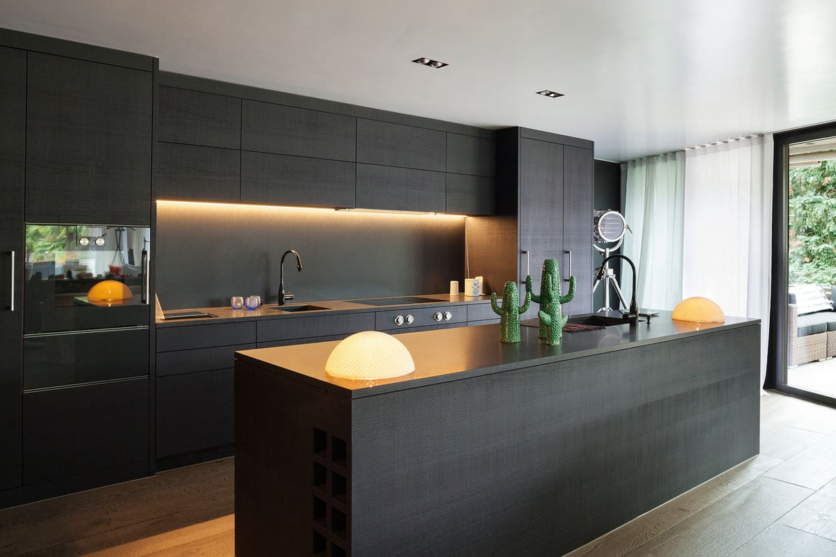 Beautiful kitchens black kitchen interior with a touch of for Black contemporary kitchen