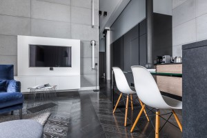 Open Living Room and kitchen with black granite and grey wall tiles