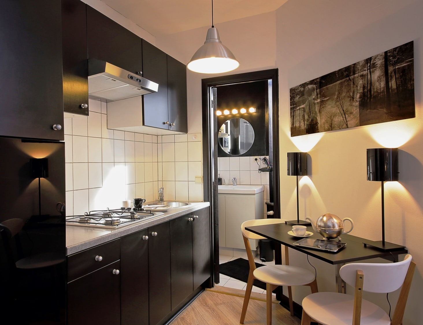 Small, soothing black kitchen