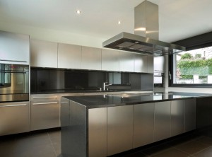 Stainless steel kitchen with black details