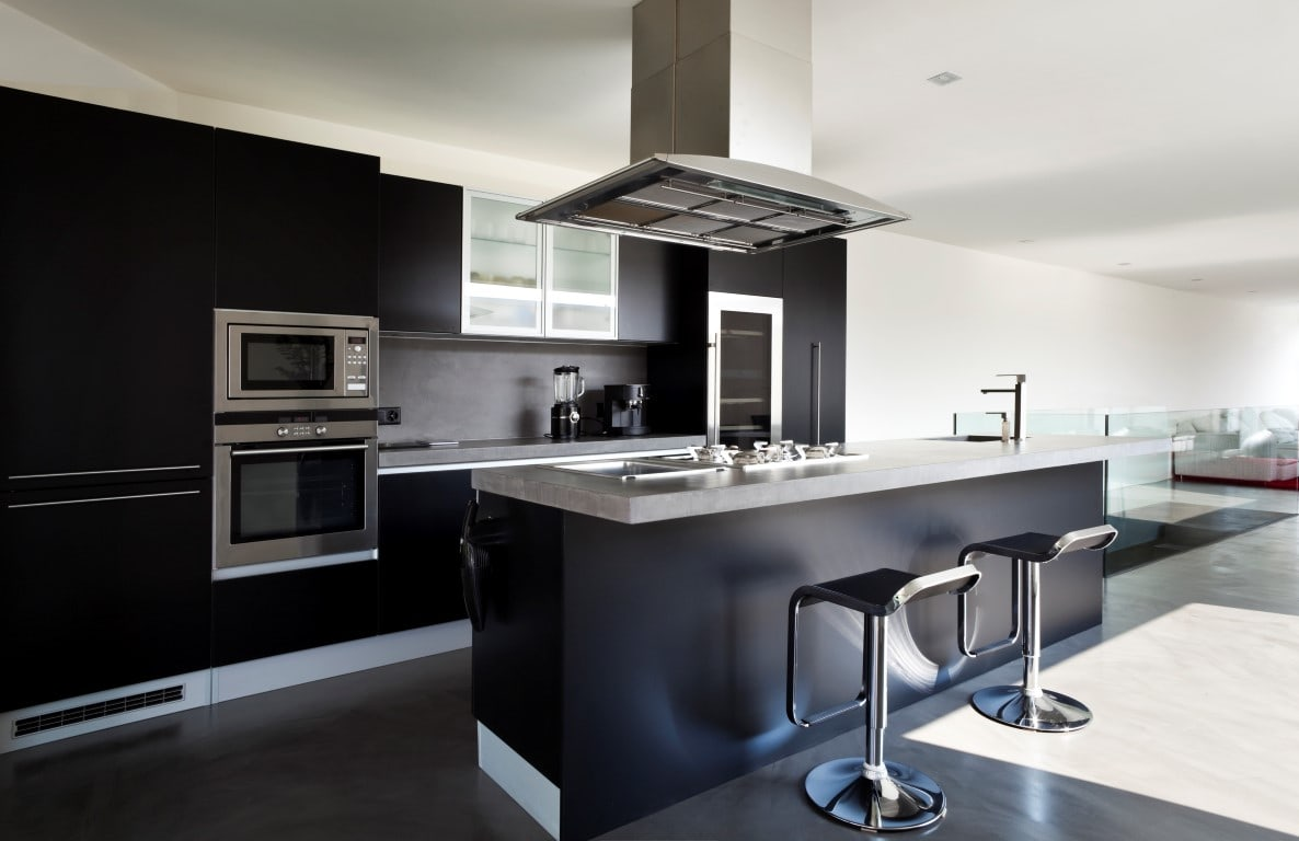 Stylish, black open plan kitchen, seamlessly extending into the living room