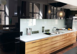 Stylish high-gloss kitchen cabinetry in black and wood