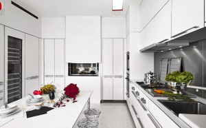 White, classic kitchen with black backsplash