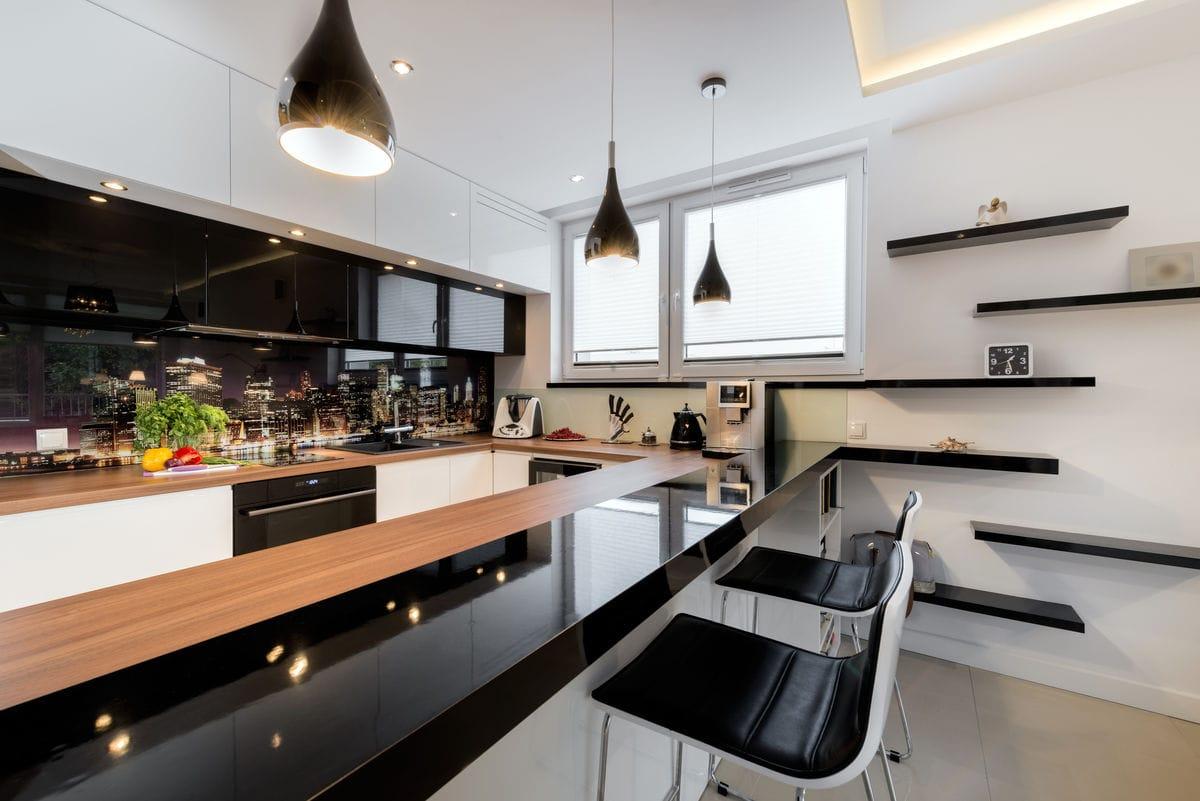 Modern black & white kitchen with black appliances.